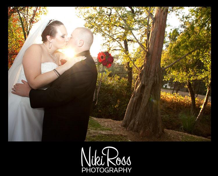 bride-groom-kissing-lensflare