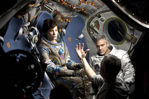 Alfonso Cuarón (foreground) directs Sandra Bullock and George Clooney in a scene for GRAVITY.