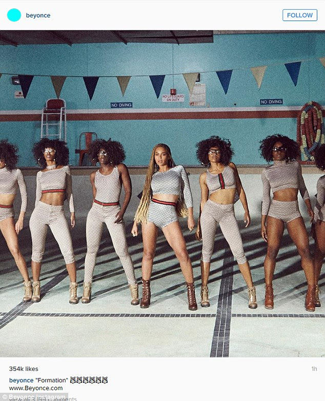 Stunning: Beyonce took to Twitter to share several images on Instagram including this one of she and her dancers all done up in the Gucci gear