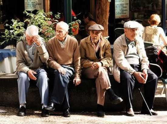 [Photo of a group of old men]