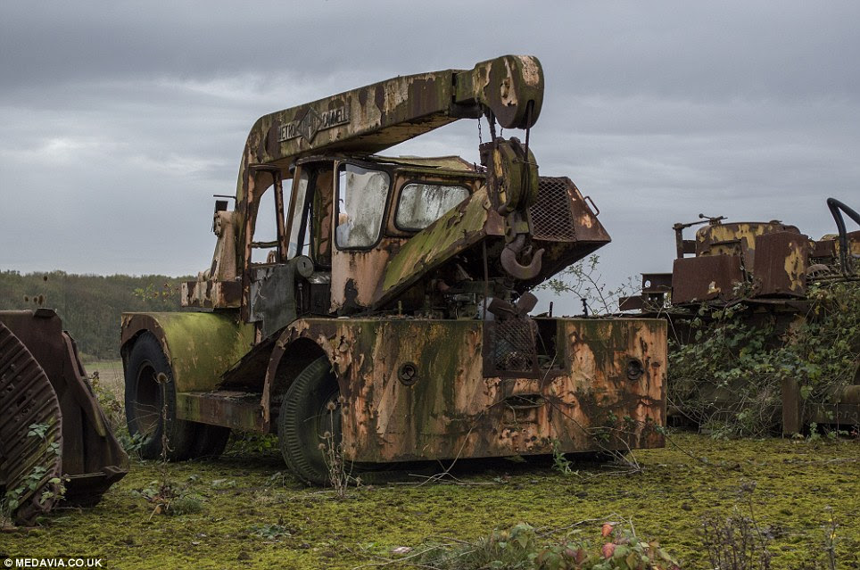 Forgotten: This disused crane stands among hundreds of other abandoned machines used by the forces up until 1963