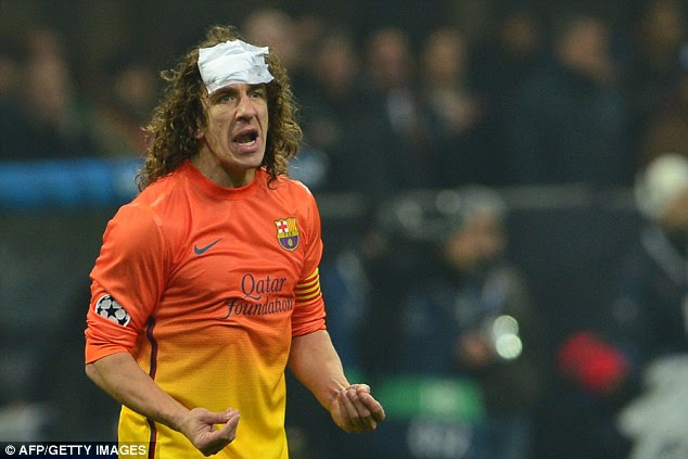 Patched up: Carles Puyol was erratic as Barcelona struggled