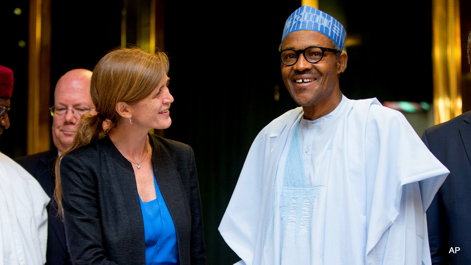 U.S. Ambassador to the United Nations Samantha Power, center left, shakes hands with Nigeria's President Muhammadu Buhari, center right, after meeting at the Presidential Villa in Abuja, Nigeria, Thursday, April 21, 2016.