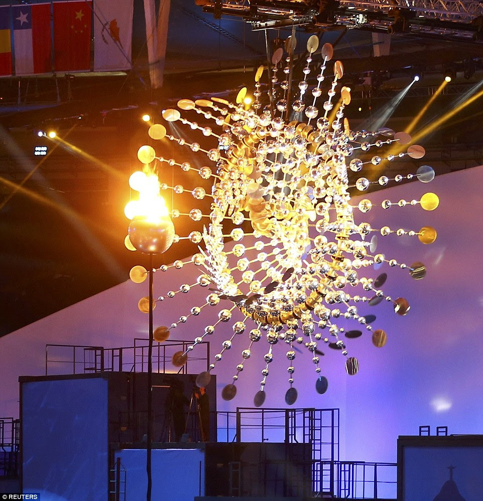The cauldron is mounted on a giant sun sculpture bearing which moves with the lit flame