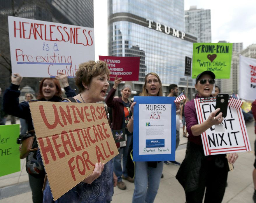 FILE - In this Friday, March 24, 2017, file photo, protesters gather across the Chicago River from Trump Tower to rally against the repeal of the Affordable Care Act, in Chicago. The Republican push to replace the Affordable Care Act was revived by a small change to their plan designed to combat concerns over coverage for those with pre-existing health conditions. But experts say the change, which helped the bill squeak through the House of Representatives, Thursday, May 4, 2017, may be too small to make much difference in the hunt for affordable coverage for these patients. (AP Photo/Charles Rex Arbogast, File)