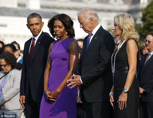 Memorial: President Obama, the First Lady, Vice President Joe Biden and his wife Jill mark the moment of the attack