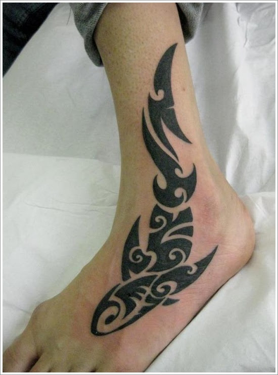 Black Ink Tribal Fish Tattoo On Left Foot