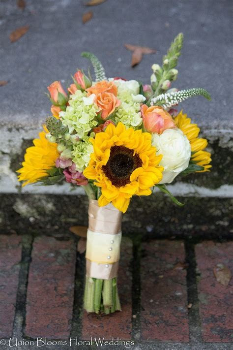 Wildflower Theme Bridal Bouquet. Ivory roses, peach spray