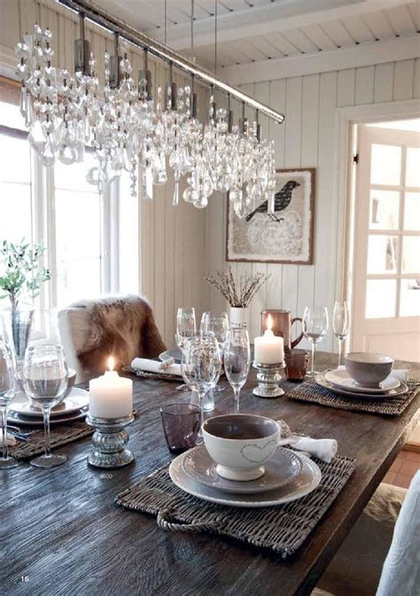 neutral dining room white cream dishes candels bird