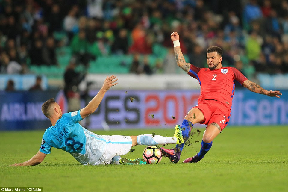 Kyle Walker (right) jumps into a challenge in a feisty first half, but neither England nor Slovenia could find the back of the net