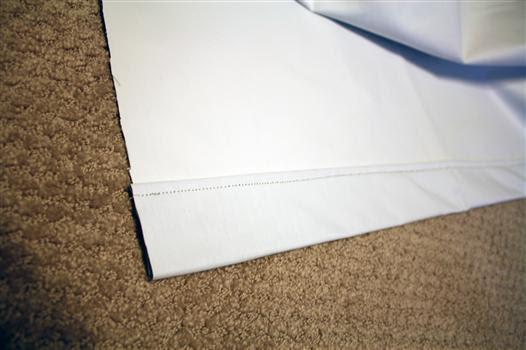 Bottom hem of drapery lining