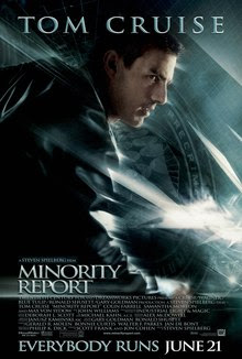 "A man wearing a leather jacket stands in a running pose. A flag with the PreCrime Department insignia stands in the background. The image has a blue tint, and many flashing lights. Tom Cruise's name stands atop the poster, and the film title, credits, and the tagline ""Everybody Runs June 21"" are on the bottom."