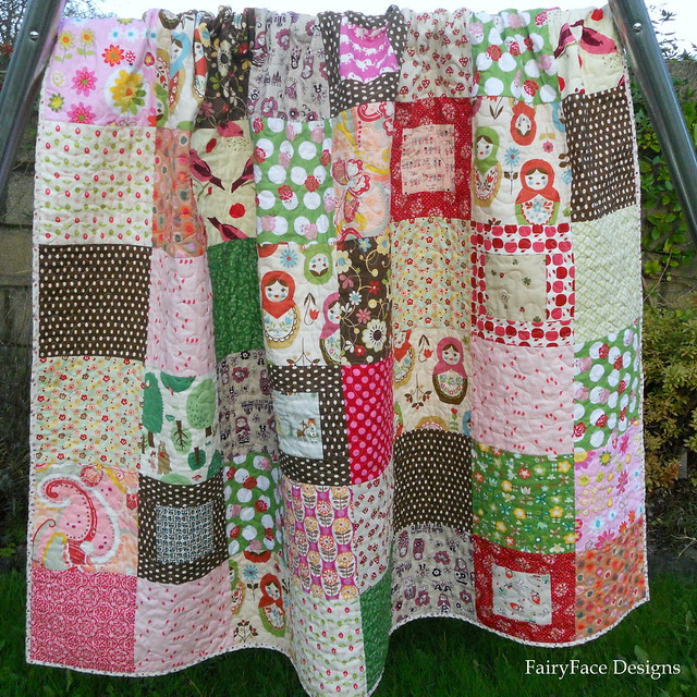Matryoshka quilt folded hanging on swing