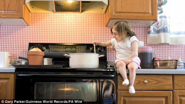 Dinner time: Bridgette Jordan takes time out to sit on her home work surface to make some food