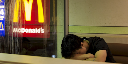 13 heartbreaking images of Hong Kong's 'McSleepers' — homeless people who live in McDonald's