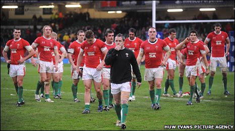 A disconsolate Wales troop off after their 33-12 hammering by Australia