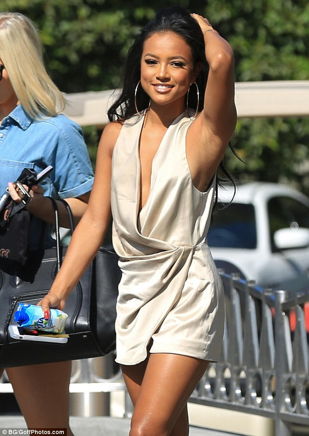 Golden goddess: Karrueche Tran as she arrived to film an episode of Extra at The Grove in Los Angeles on Tuesday