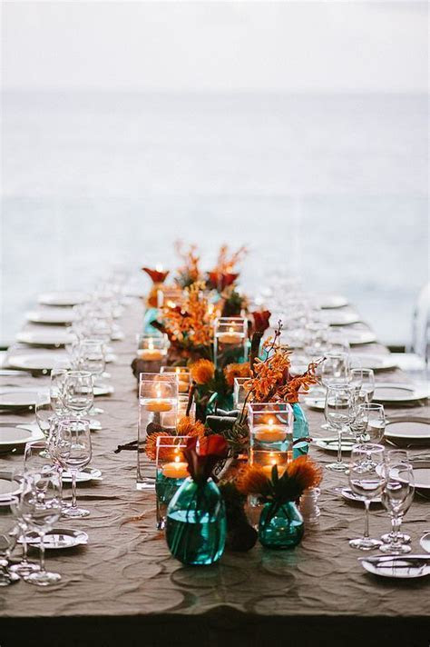 Picture Of teal vases and jars with copper and orange