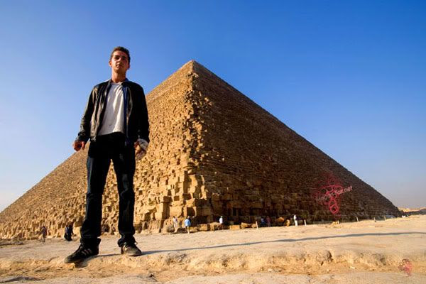 Shia LaBeouf posing in front of an Egyptian pyramid.