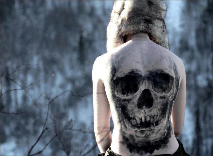 Large Skull Tattoo On Girl Back