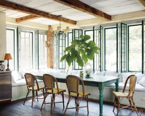 Long banquette in eat in kitchen, of course the black windows too