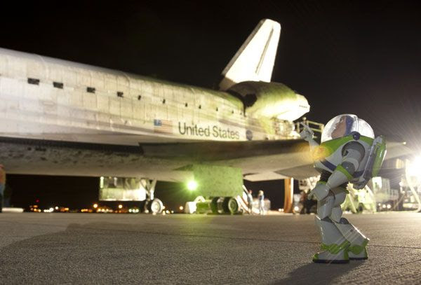 Buzz Lightyear gazes at the spacecraft that took him home on September 11, 2009.