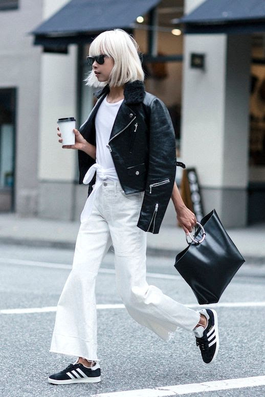 Le Fashion Blog Blogger Style Blonde Short Hair Sunglasses Fur Collared Leather Jacket Knotted Tee Metal Handle Bag Flare Raw Hem White Jeans Black Adidas Sneakers Via The Haute Pursuit