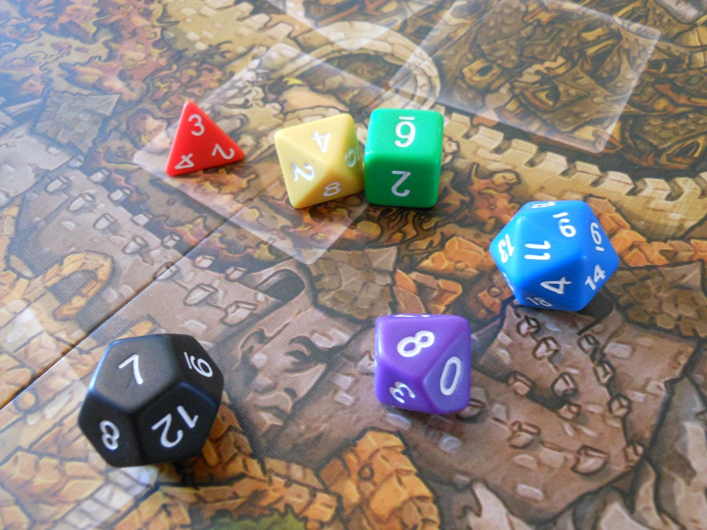 Jim Henson's Labyrinth: The Board Game uses a set of special dice for resolving conflicts.