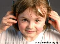 A child listens with headphones