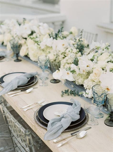 Stunning & elegant muted blue floral wedding tablescape