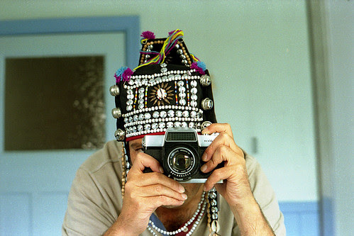 reflected self-portrait with Fujicarex camera and Thai hat by pho-Tony