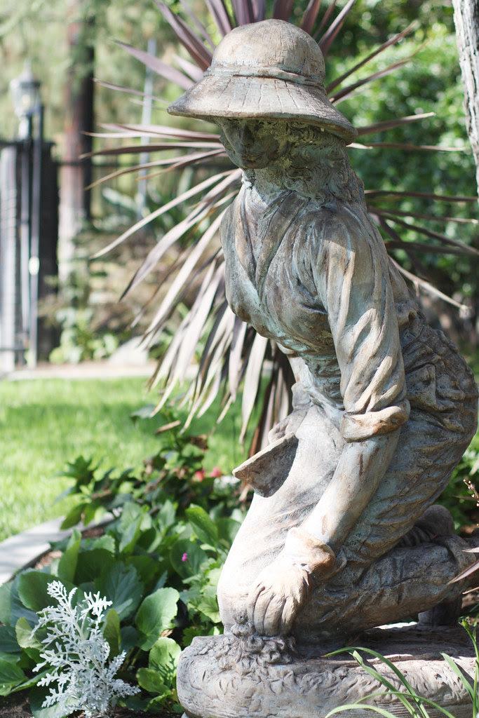 stone statue gardener