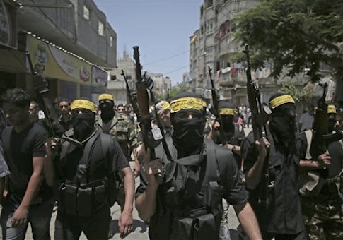 Masked militants march with guns