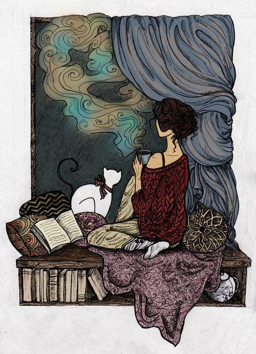 A cup of tea, a cat, and a book. Perfect.