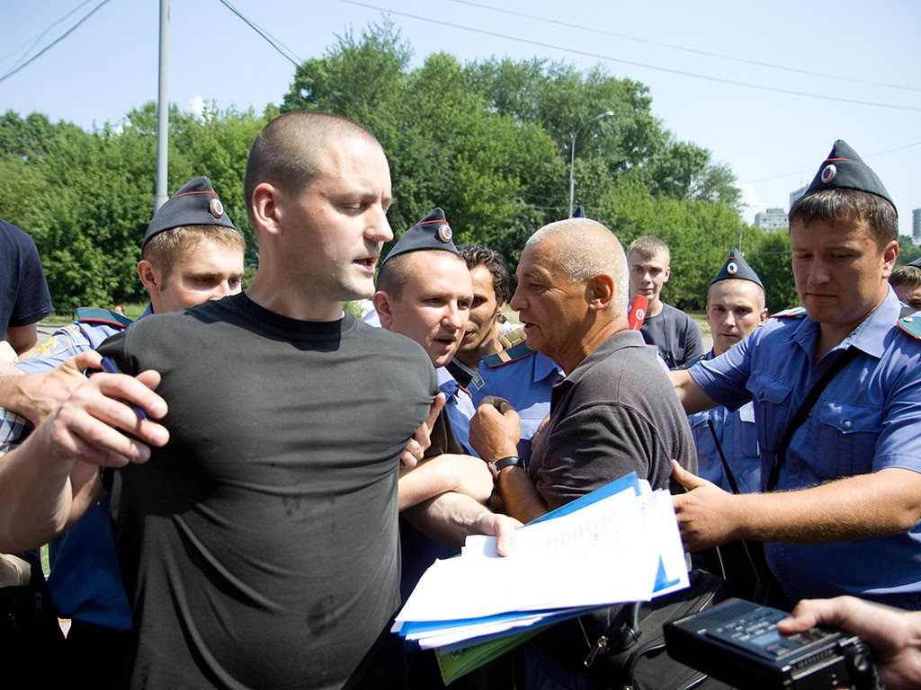 "Police detain Sergei Udaltsov. Ecologist and Left Front activists bring ""Woods of Khimki forest"" to the building of Government of Russian Federation"