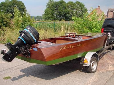 Side by side, a mahogany runabout
