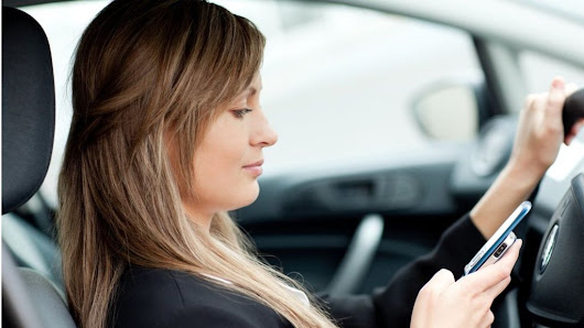 Thousands caught in car phone crackdown
