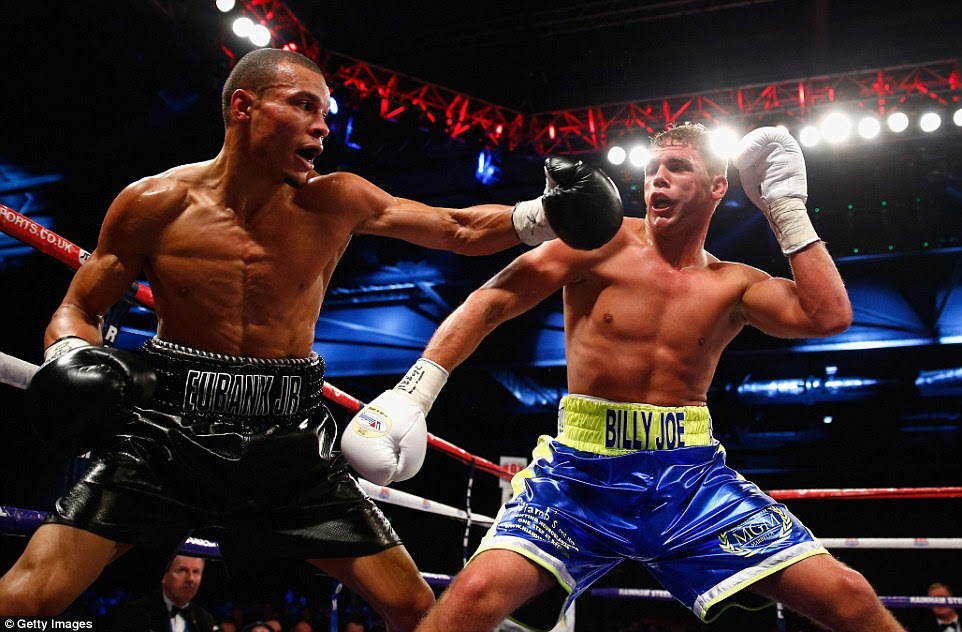 Saunders (right) uses his quick feet to escape from Eubank Junior's left hook in front of a capacity crowd at the ExCeL centre