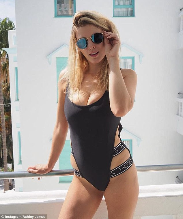 Beach babe: Former Made in Chelsea star Ashley looked in a saucy black swimsuit on Friday, as she posted a cheeky holiday selfie from her Ibiza holiday on Instagram