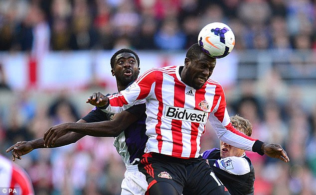 Heads up: Altidore is challenged by Kolo Toure