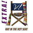 Extra! – Kat in the Hot Seat