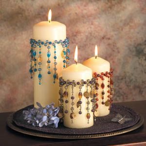 Beaded candles - inspiration only - would probably apply these to the glass, since dripping wax would ruin a lot of work otherwise! Make collars, pin to candles, to burn, put rubber band around candle jar & lower collar to cover it, then put candle in jar to burn - best of both worlds :)