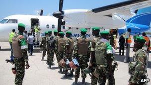 AU troops boarding a plane in Mogadishu to head for Baidoa, 5 April 2012