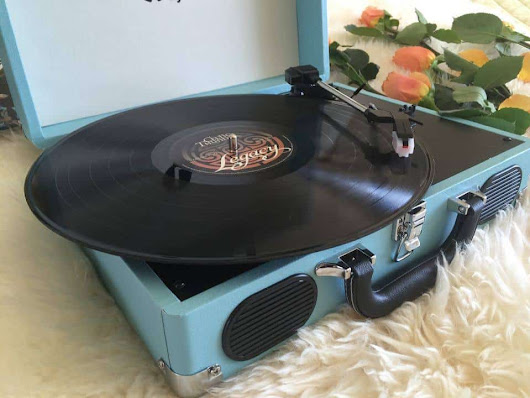 Play Your Records On A Stereo Turntable Amplified With Speakers