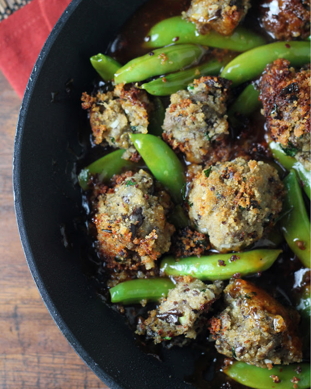eggplant meatballs and sugar snap peas in a sesame ginger sauce