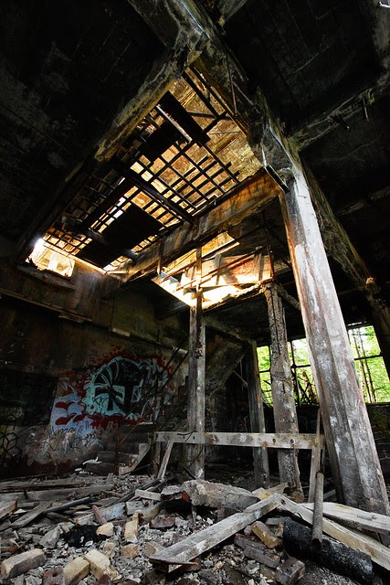 Quincy mill ruins with sunlight filtering in.
