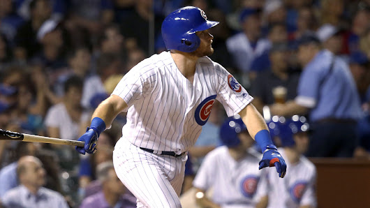 Cubs hit 4 homers to beat Reds at Wrigley
