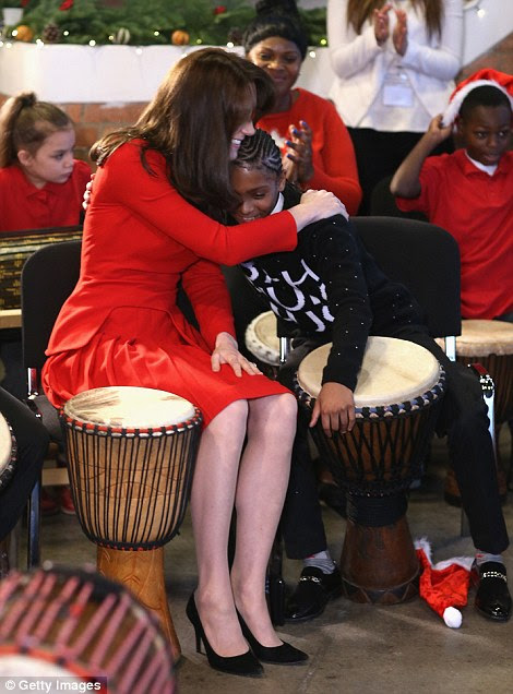 Members of the centre looked on as caring Kate leaned in and gave the youngster a hearty hug following their musical showcase