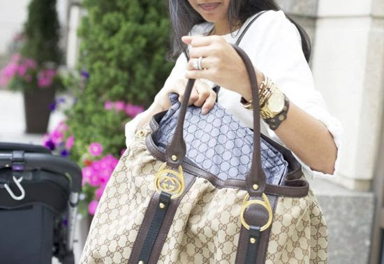 """Now you don't have to feel the """"mommy blahs"""" of not being able to carry your favorite designer handbag anymore!  http://coquette.blogs.com/maman/2014/05/quintessential-mommy-baby-bag-organizers.html  #quintessentialmommy #quintstyle #moms #bags #accessories #momstyle"""