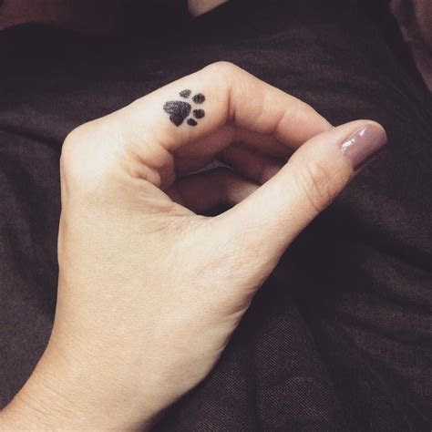paw print on finger   this is my favorite [small] tattoos